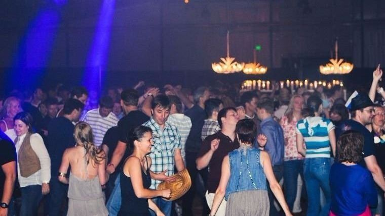 Guests dancing at event