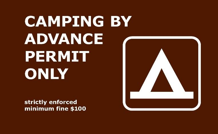 Camping by advanced permit only sign with tent logo