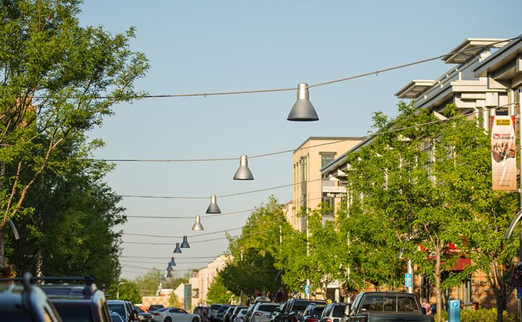 Downtown street with hanging lamps